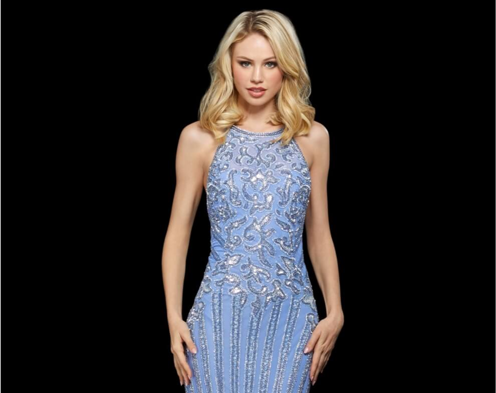 Model wearing a blue prom dress