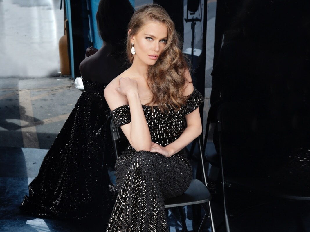 Model wearing a black evening dress