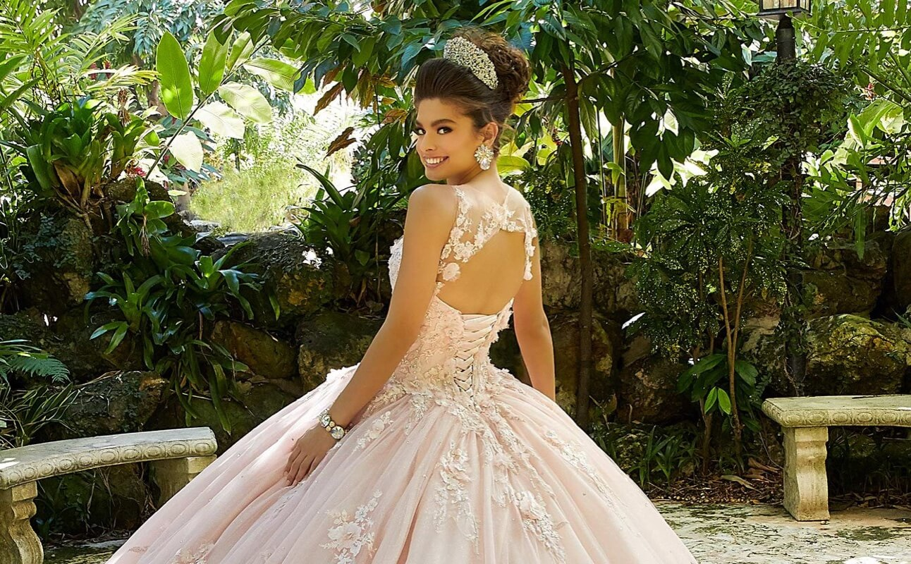 Model wearing a white quinceañera dress