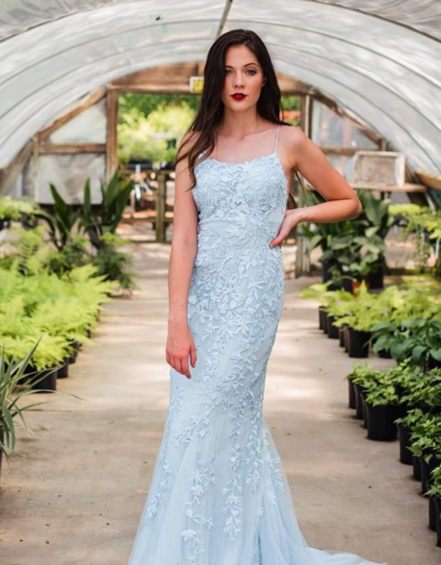 Model wearing blue Sherri Hill dress
