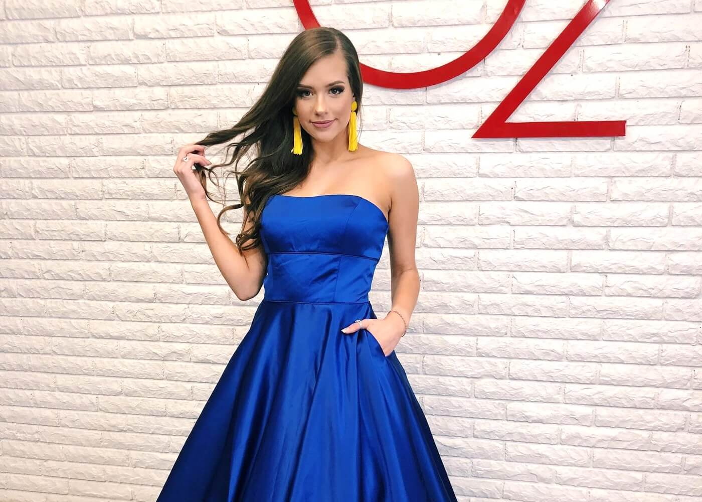 Our girl wearing a blue evening dress